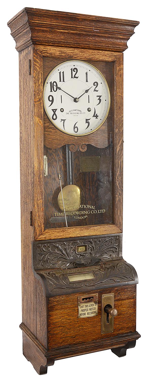Lot 12 - An oak cased International Time Recording Ltd clocking in/clocking out clock