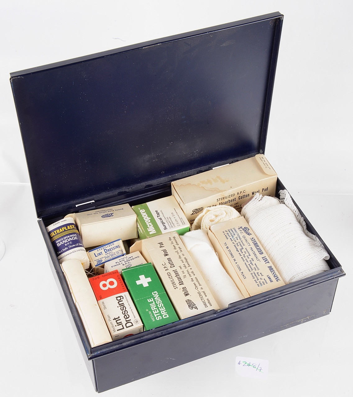 Lot 29 - A vintage navy blue Boots 'First Aid' tin