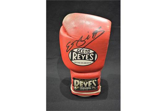 Boxing - a Reyes Boxing glove, used, signed in pen by