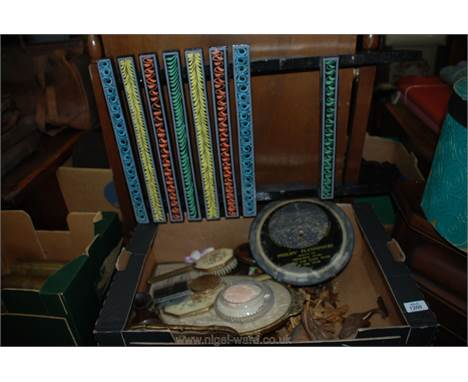 A box of miscellaneous carved wooden animals, Philip's Planisphere, dressing table tray, etc