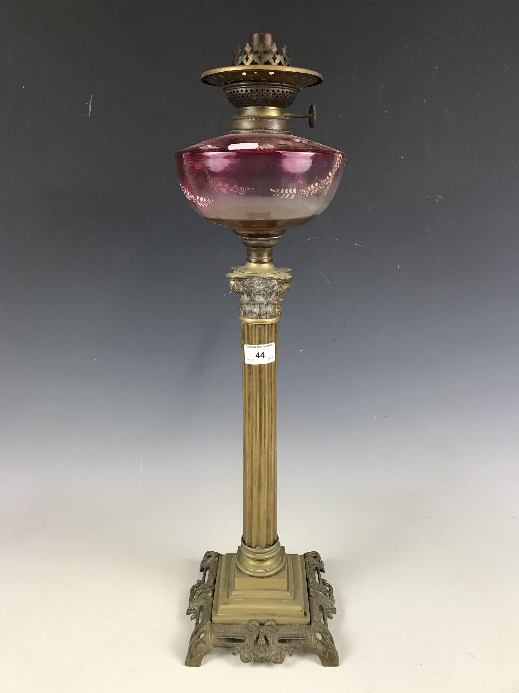 Lot 44 - A columnar oil lamp