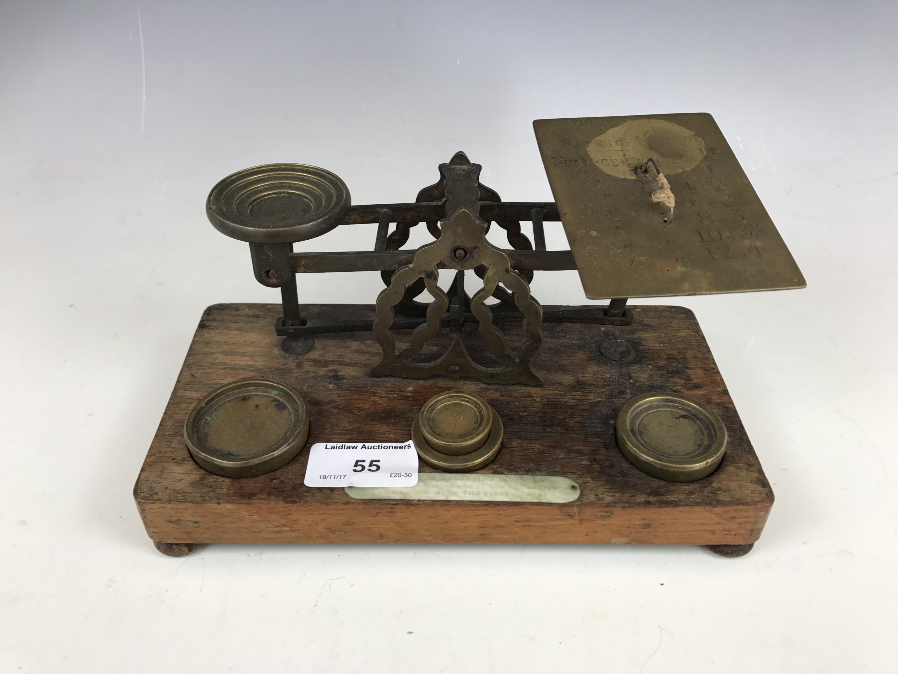 Lot 55 - A set of Victorian brass postal scales and weights, on oak platform base bearing ivory plaque