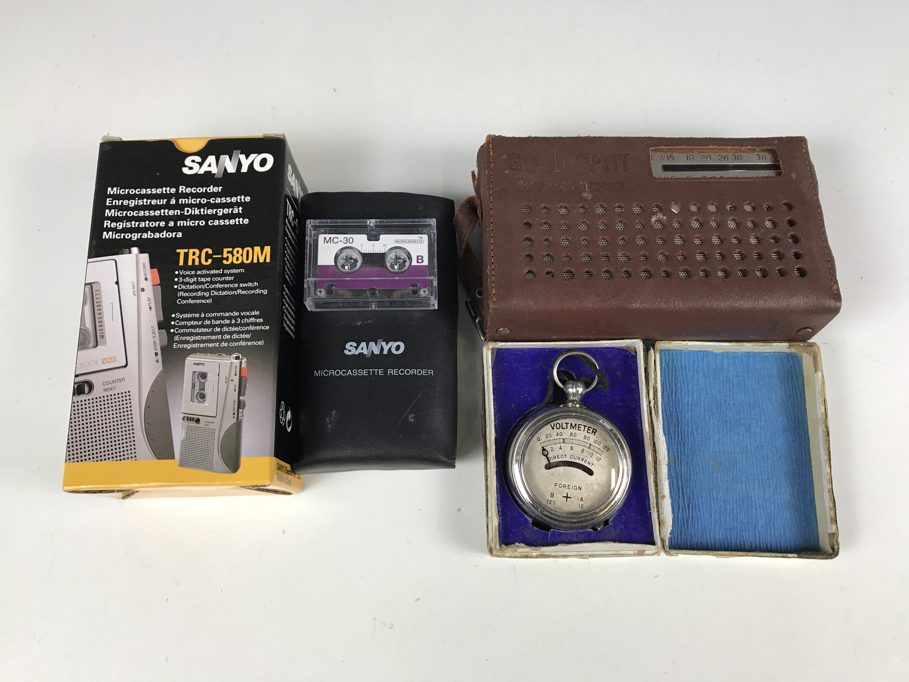 "Lot 35 - A 1960s Gold Spot eight transistor ""Deluxe"" portable radio together with a Sanyo TRC-580M micro-"