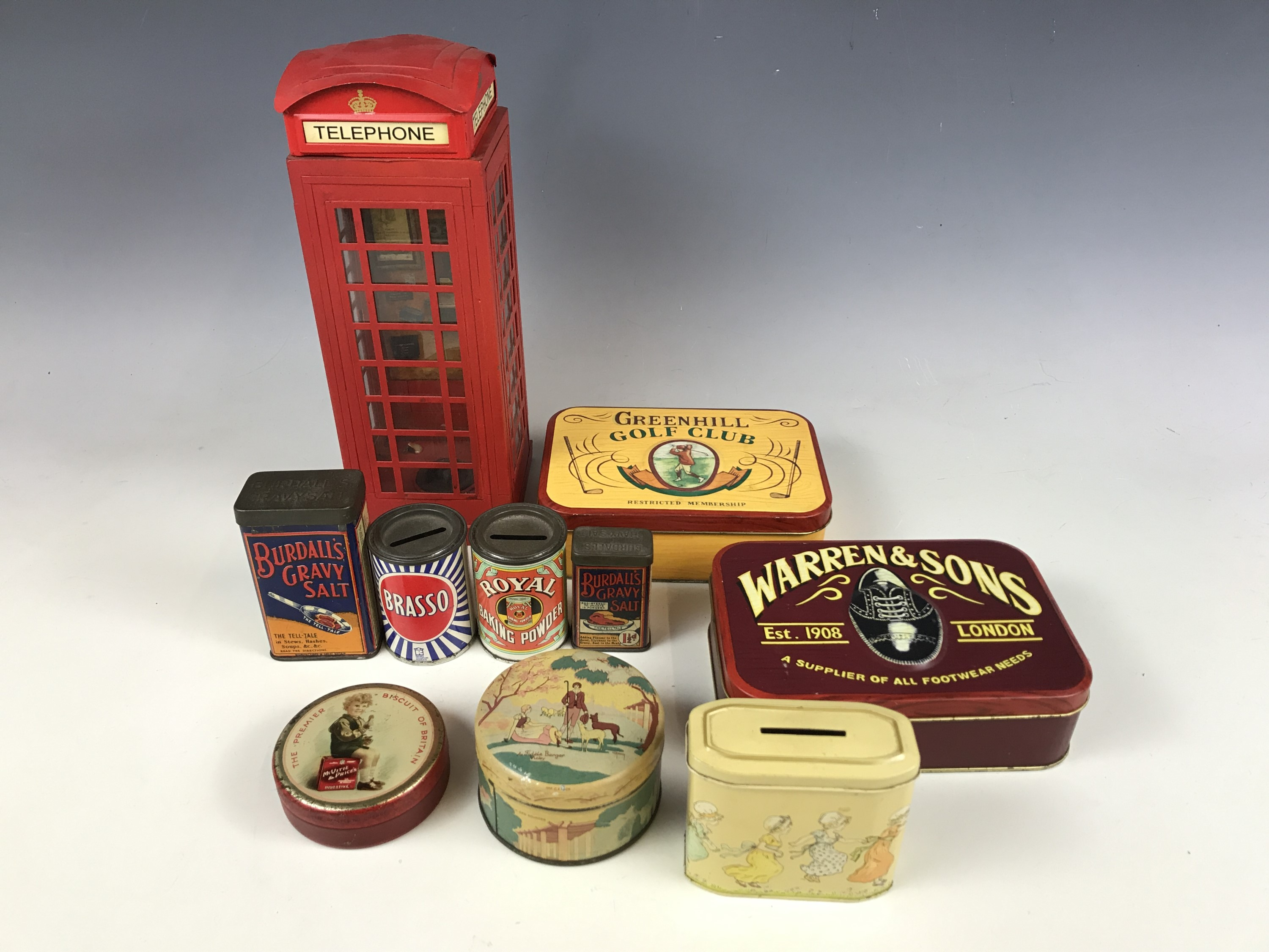 Lot 27 - Various advertising tins together with a telephone money box