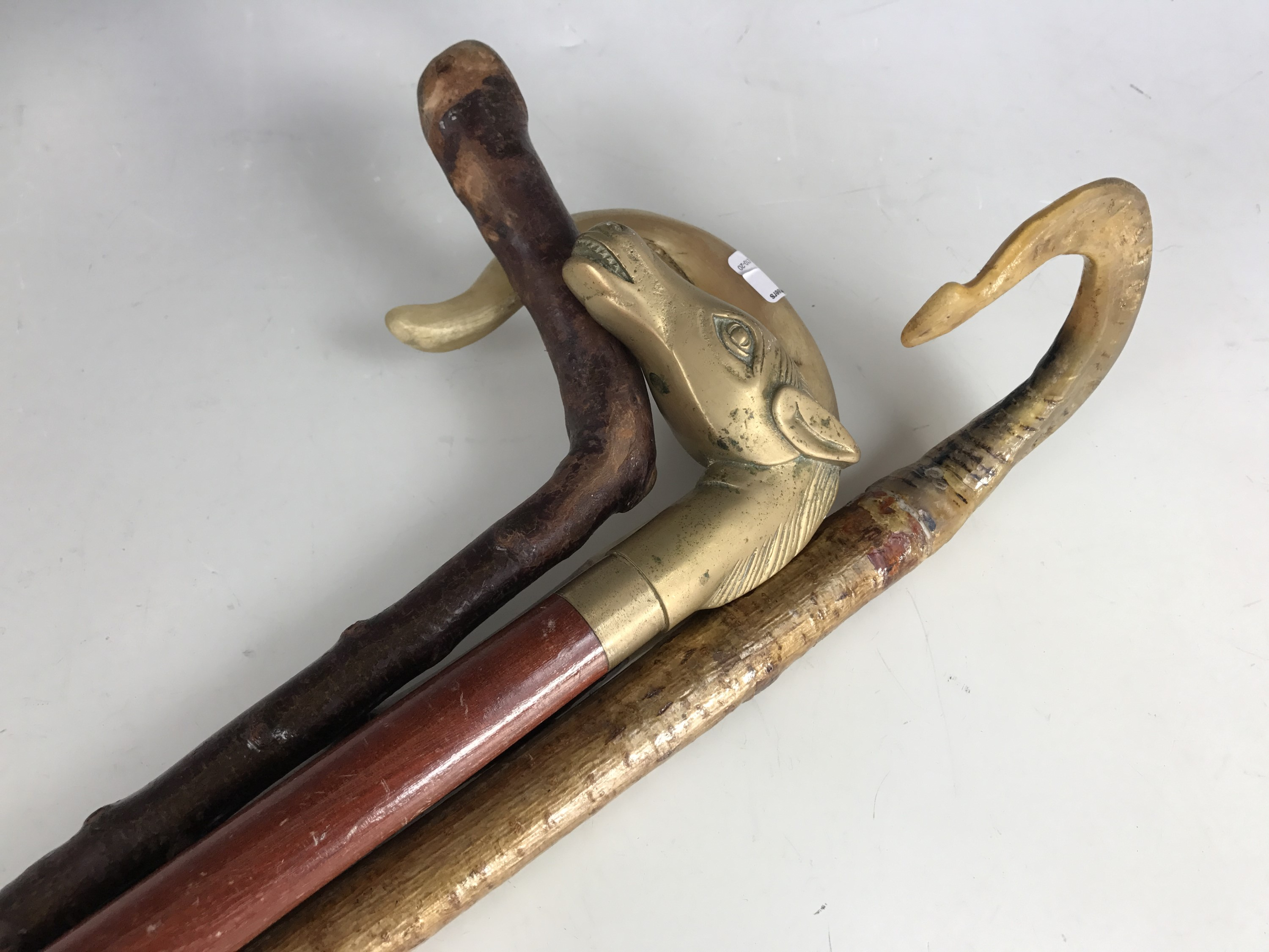 Lot 6 - Two horn handled walking sticks together with two others