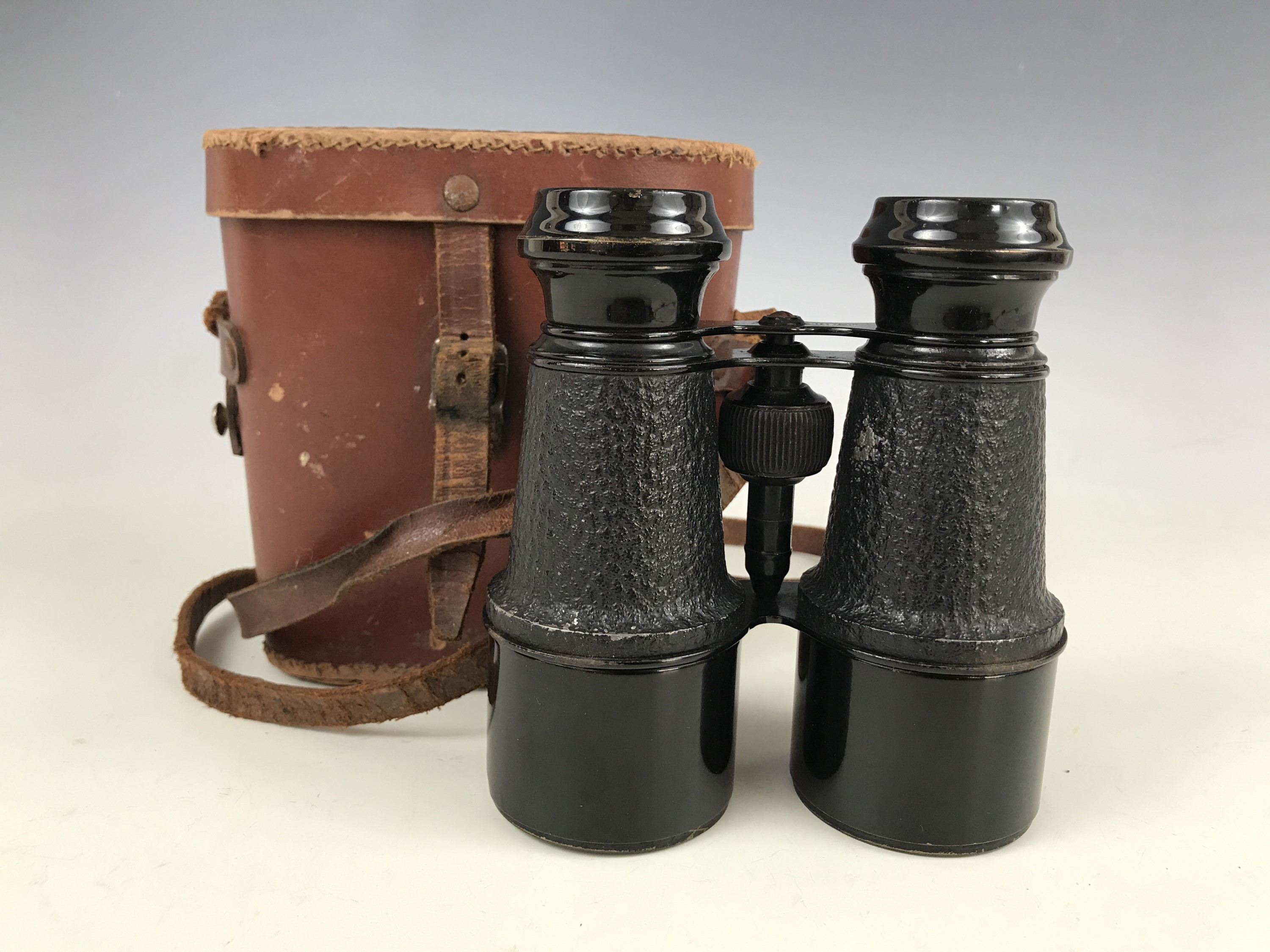 Lot 30 - A cased pair of French field glasses