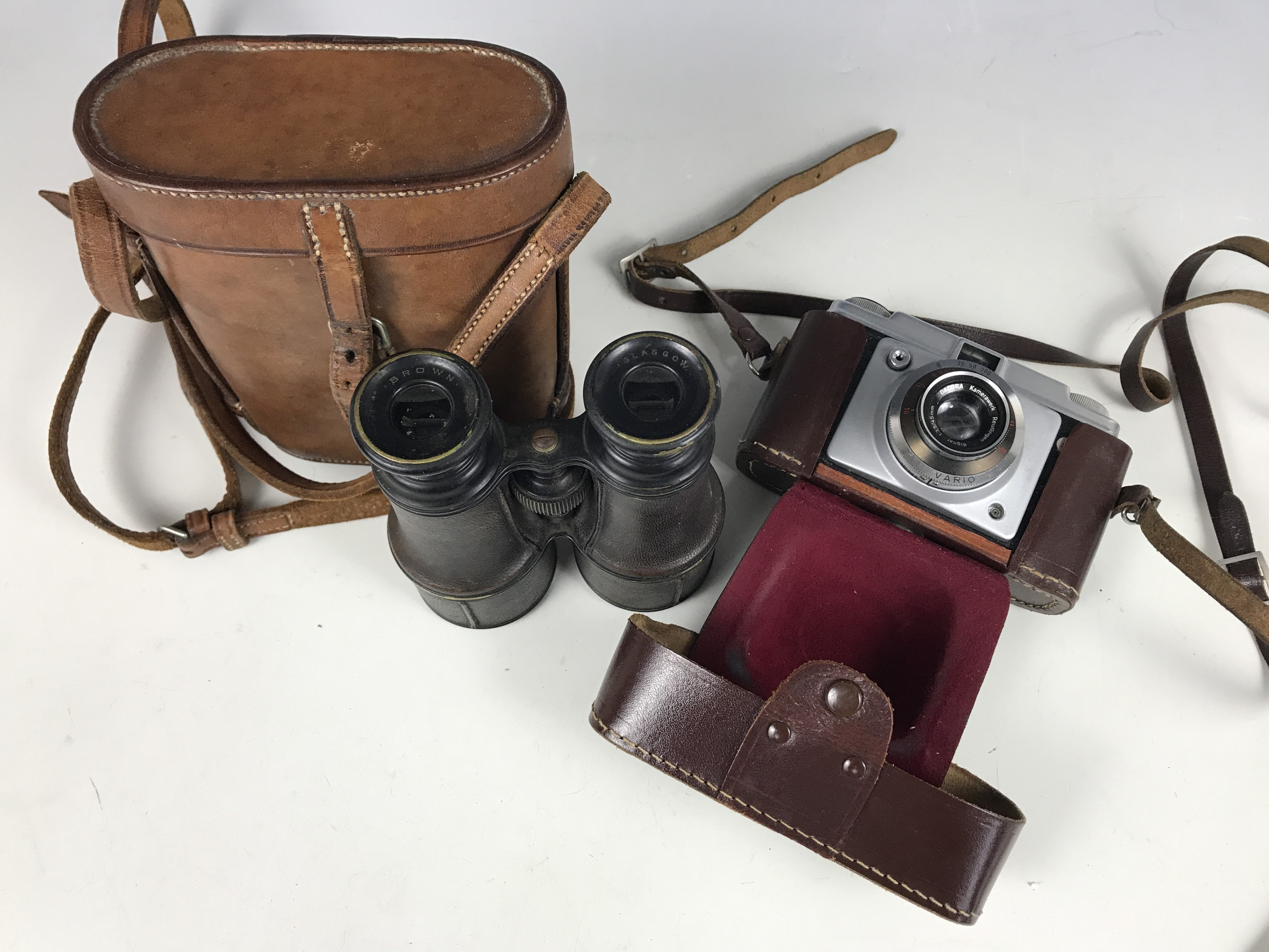 Lot 43 - An early 20th century set of binoculars and an Ilford camera