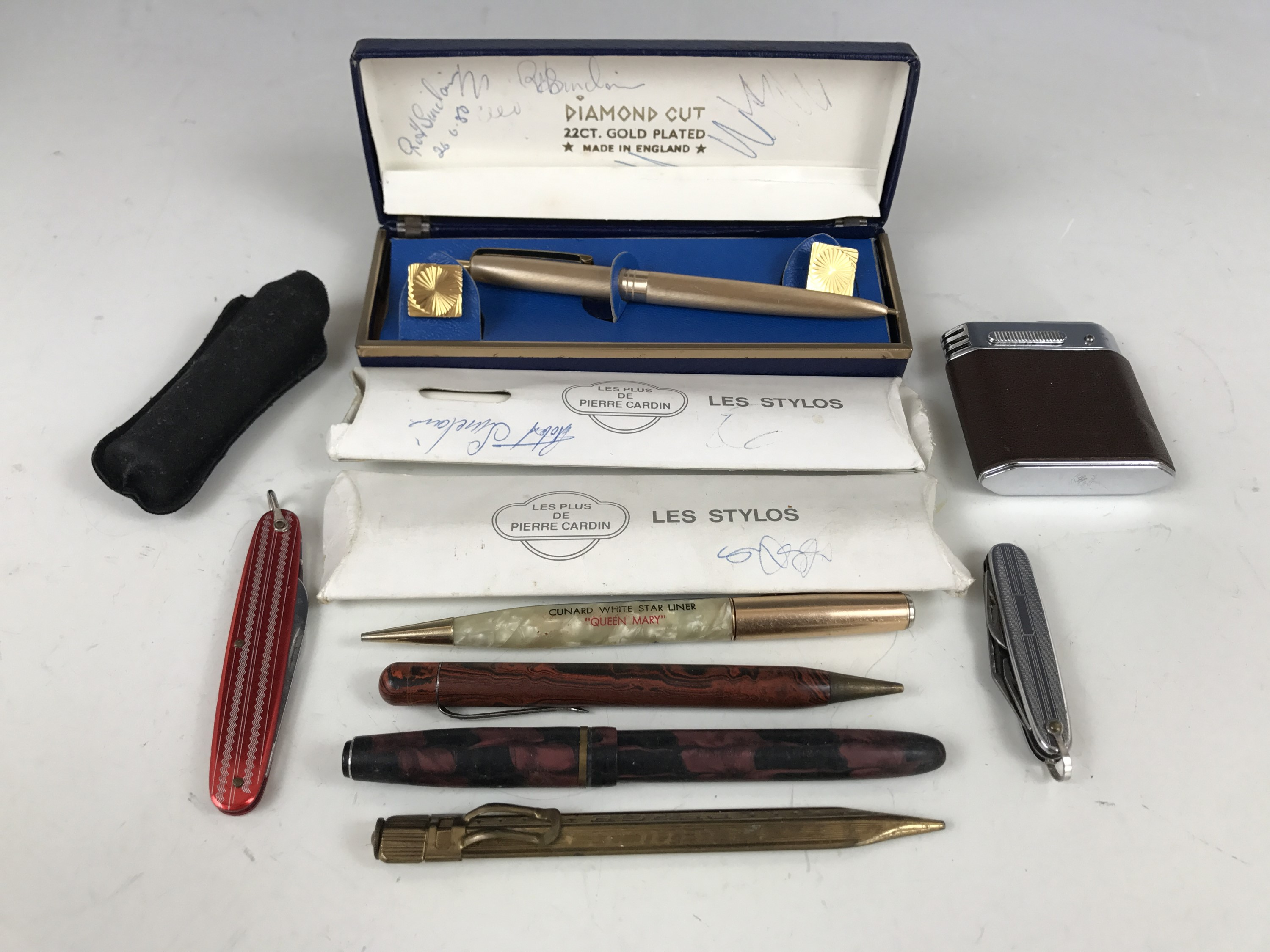 Lot 34 - A Magna cigarette lighter together with two pen knives and propelling pencils etc