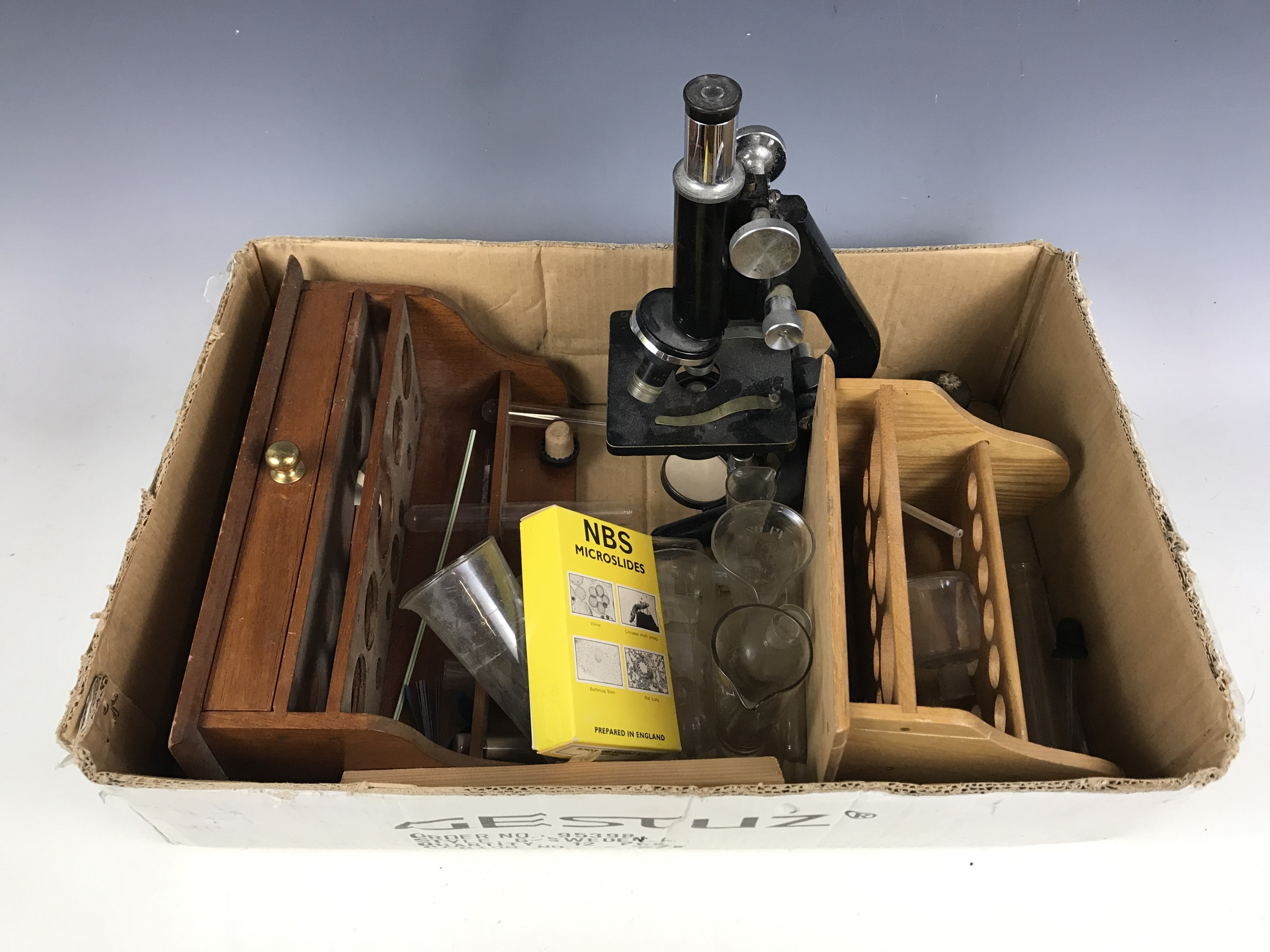 Lot 56 - A Kima microscope by Watsons & Son Ltd of London together with test stands etc