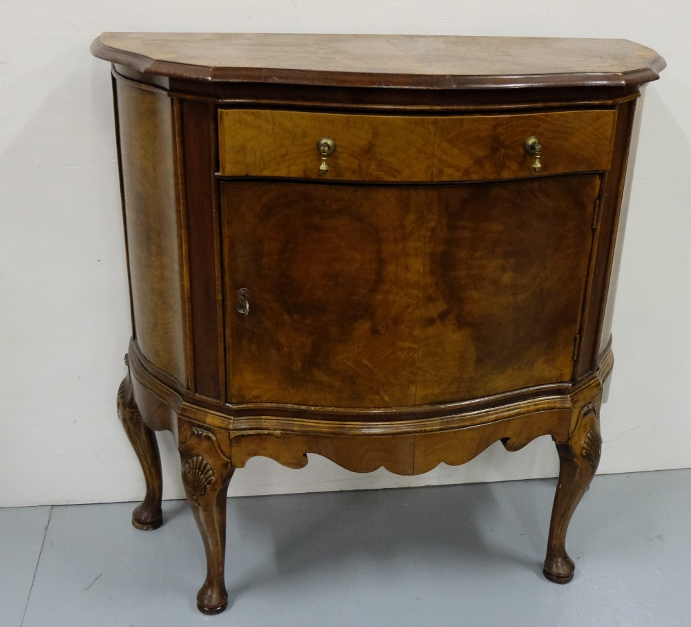 Lot 6 - Walnut Side Cabinet, with a serpentine front, apron drawer and single door, on Queen Ann legs, 33""