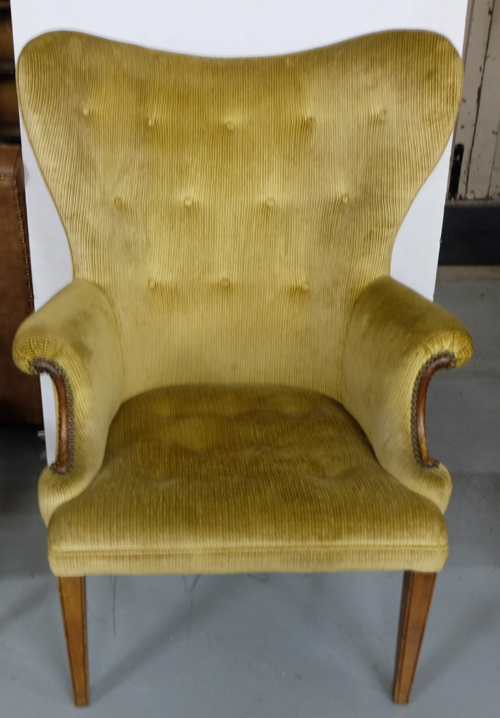 Lot 1 - Wingback Armchair, on tapered mahogany legs, beige fabric