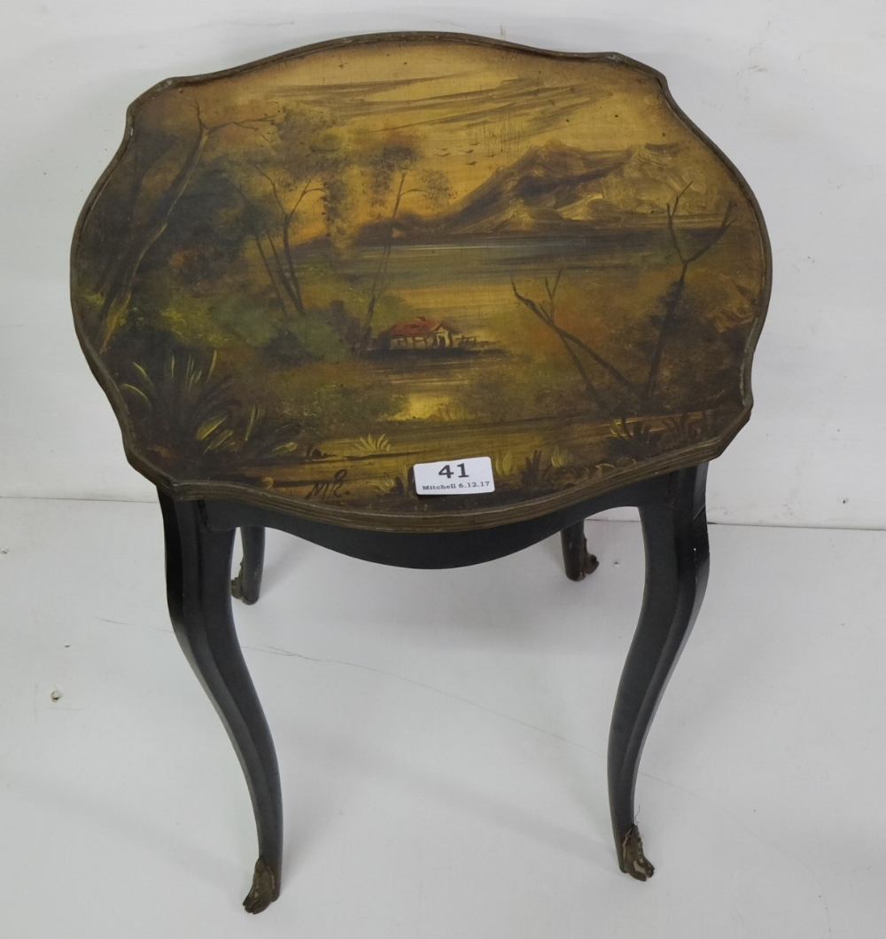 "Lot 41 - Hand Painted Lamp Table, with country scene, signed by the artist M.R, on sabre legs, 20""h x 15""w"