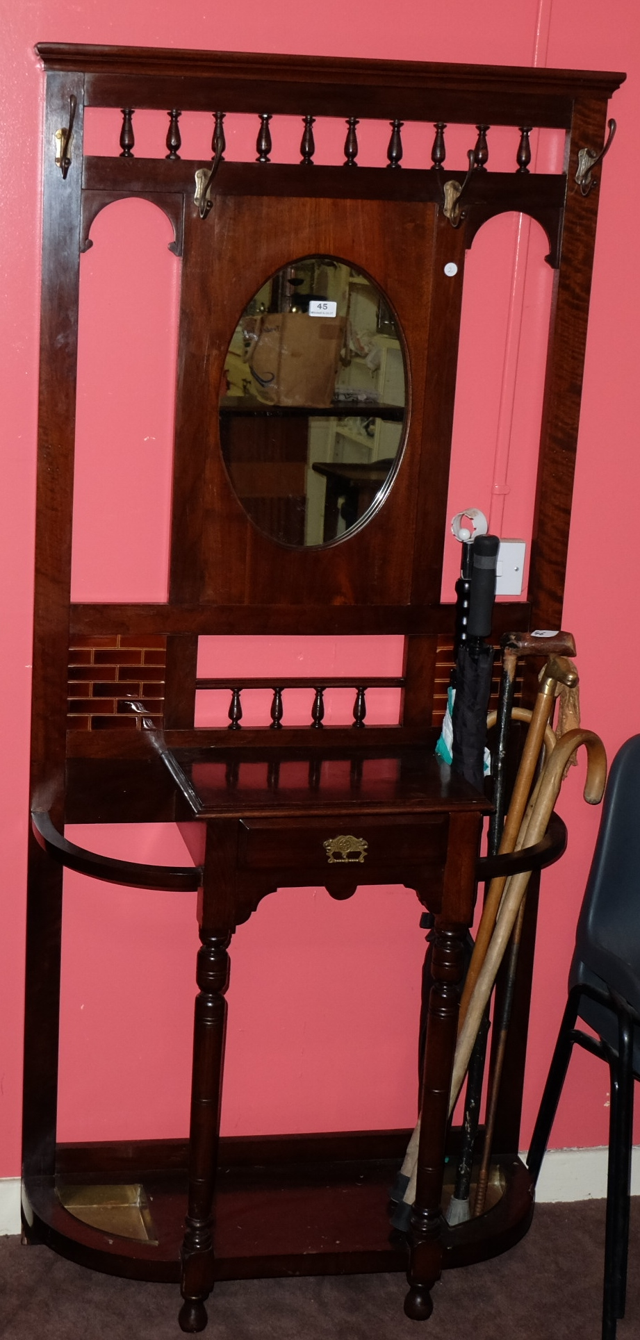 "Lot 45 - Mahogany Hallstand, with oval mirror and red tile inserts, 22""w x 73""h"