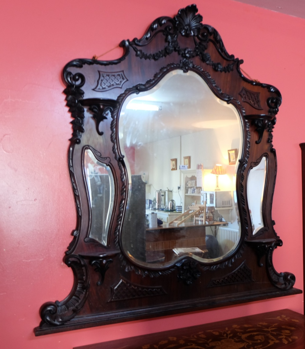 Lot 44 - Mahogany Framed Overmantle, with a serpentine shaped top, over ornate fretwork and carvings, 3