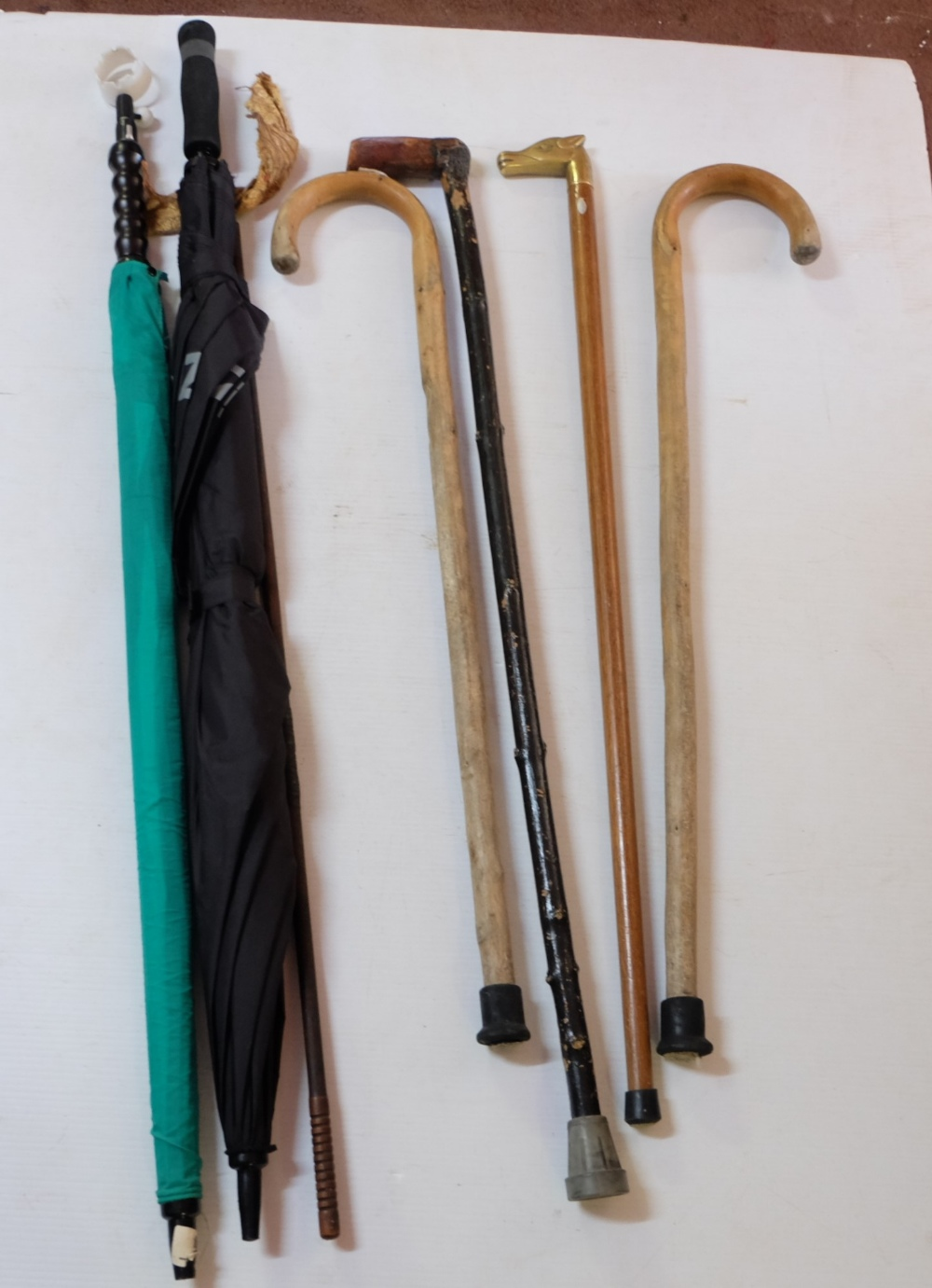 Lot 46 - Group of 5 walking sticks & 2 umbrellas (7)