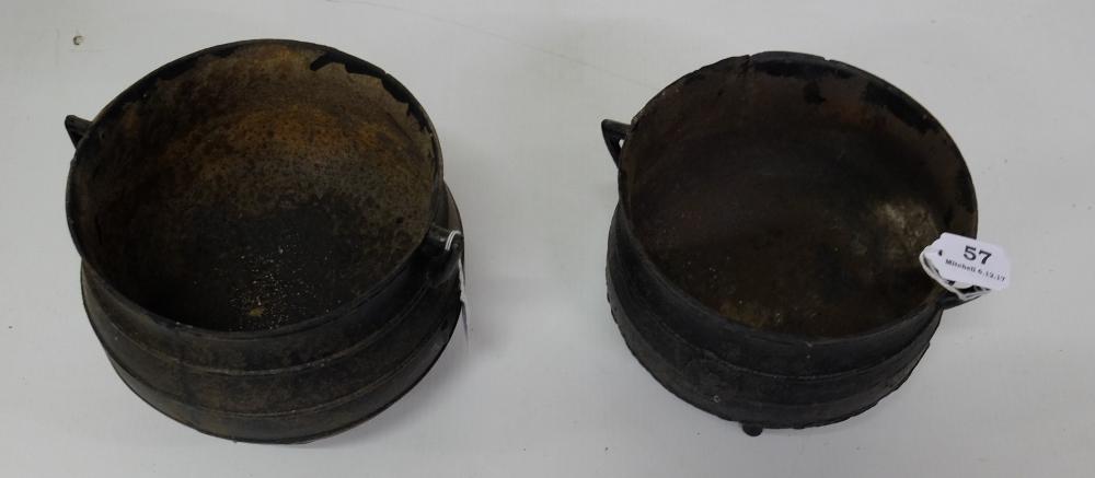 "Lot 57 - Similar Pair of Cast Iron Skillet Pots on feet, each 8"" dia"