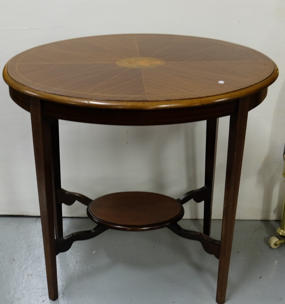 "Lot 35 - Oval Mahogany Two Tier Occasional Table with an inlaid top and stretcher shelf, 24""w"