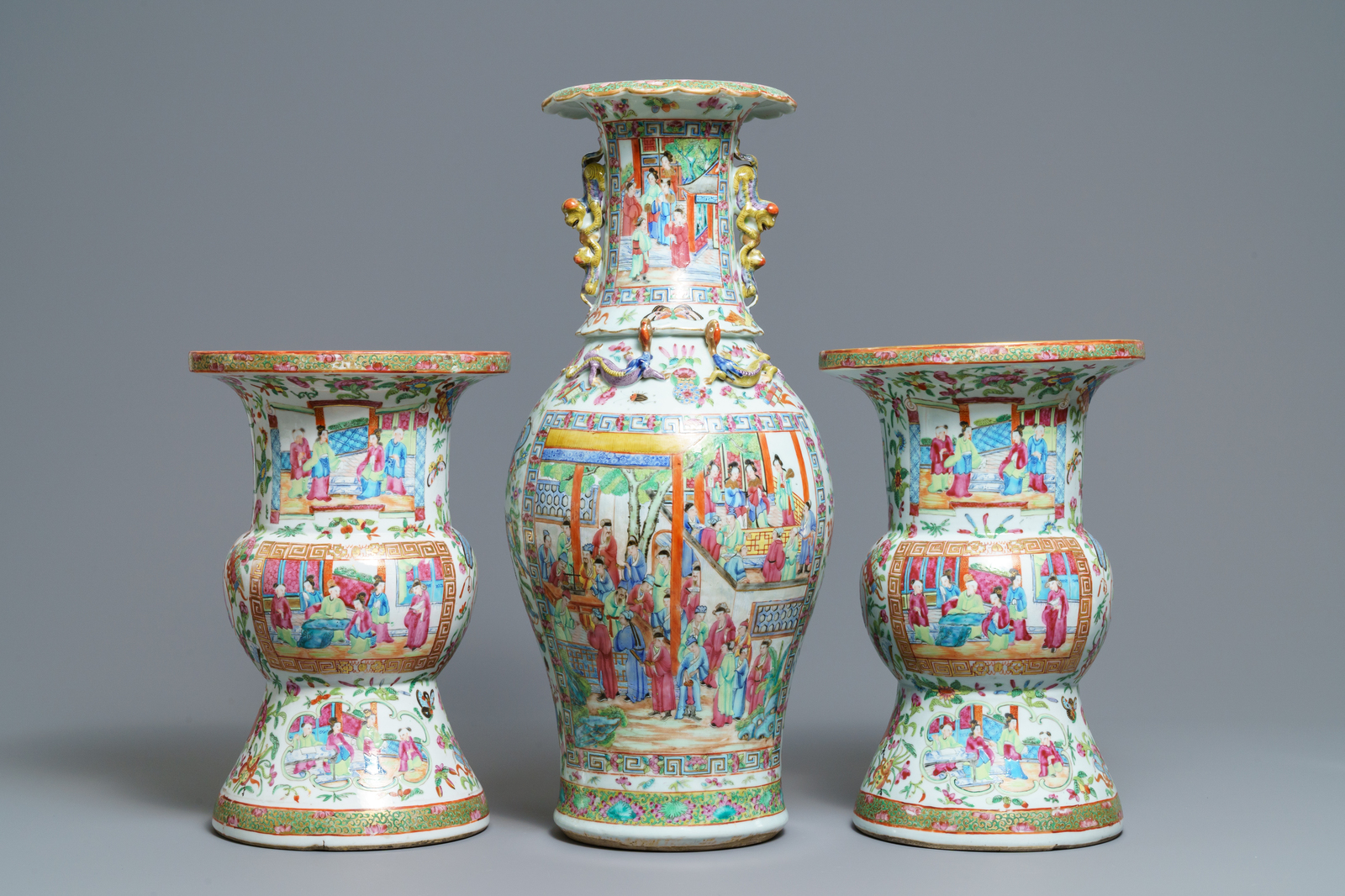 A pair of Chinese Canton famille rose spittoons and a vase, 19th C. - Image 3 of 6