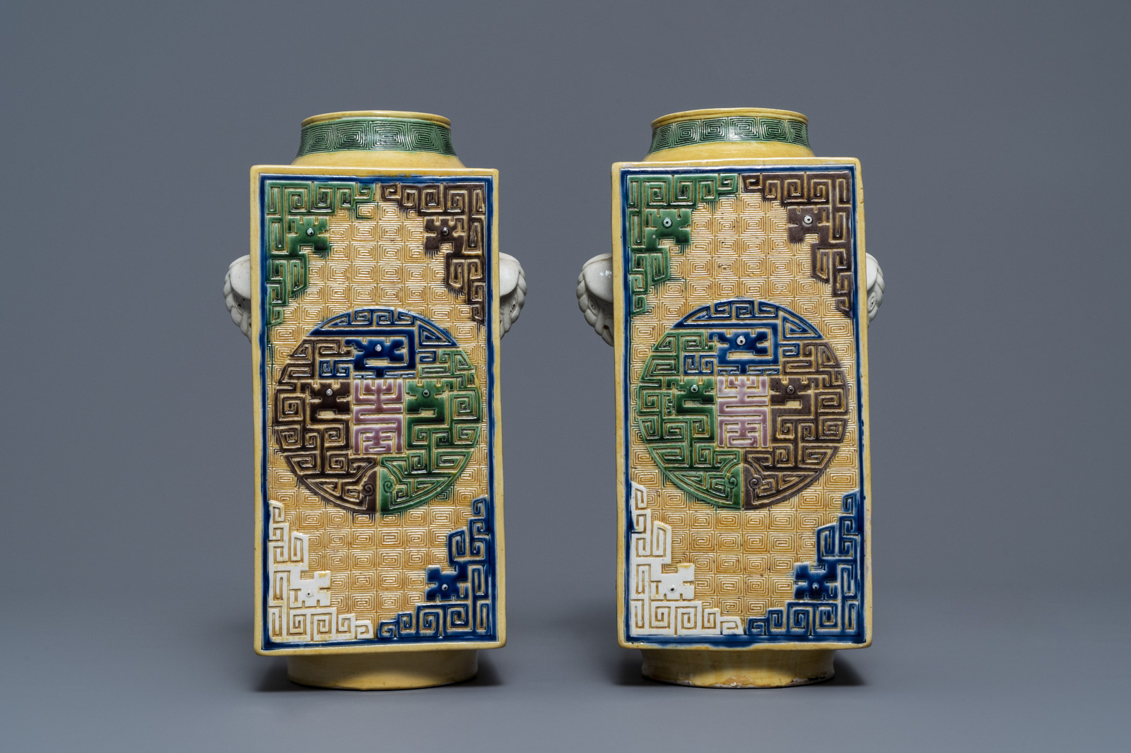 A Chinese celadon jardinire and a pair of relief-decorated cong vases, 19/20th C. - Image 8 of 13