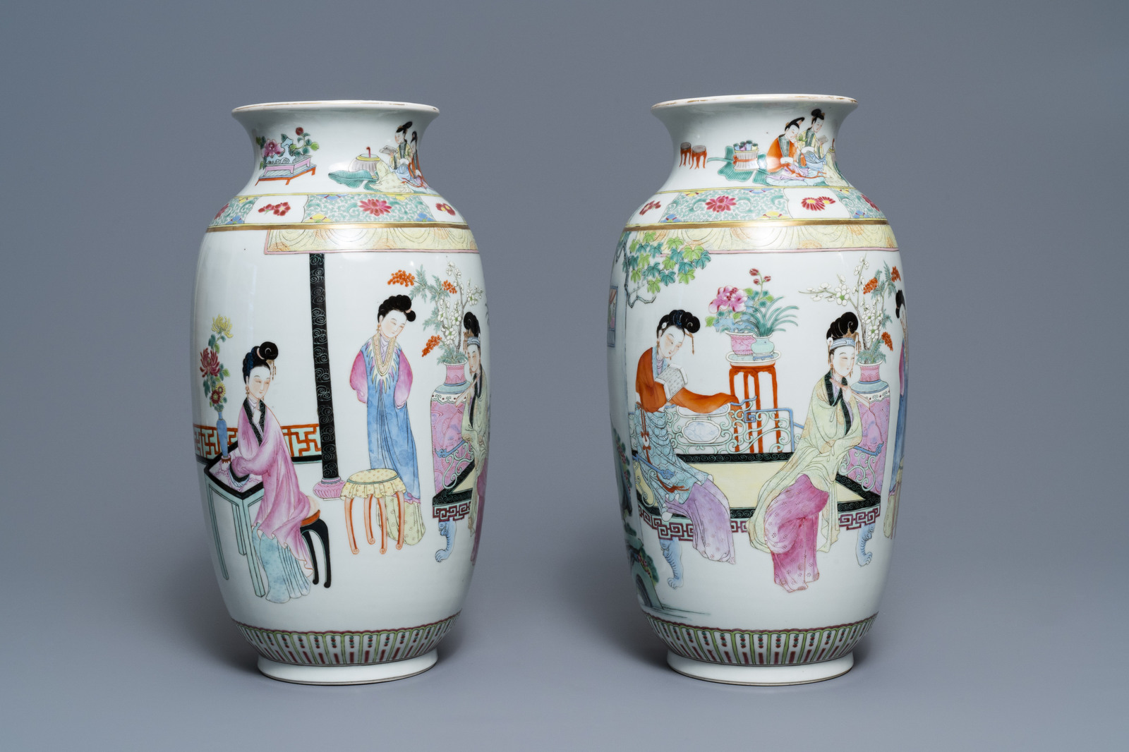 Lot 43 - A pair of fine Chinese famille rose 'ladies' vases, Qianlong mark, 19/20th C.