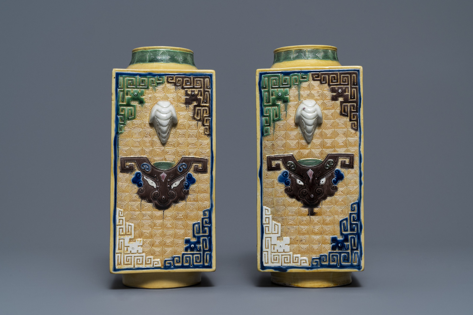 A Chinese celadon jardinire and a pair of relief-decorated cong vases, 19/20th C. - Image 9 of 13