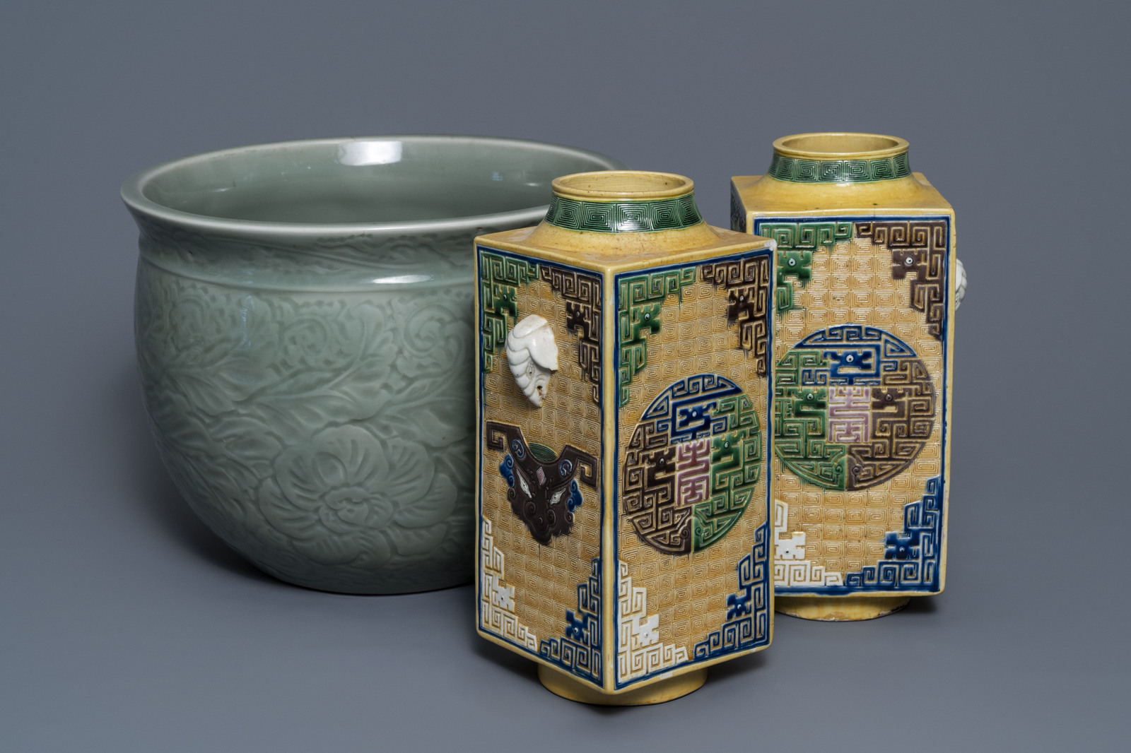 A Chinese celadon jardinire and a pair of relief-decorated cong vases, 19/20th C.