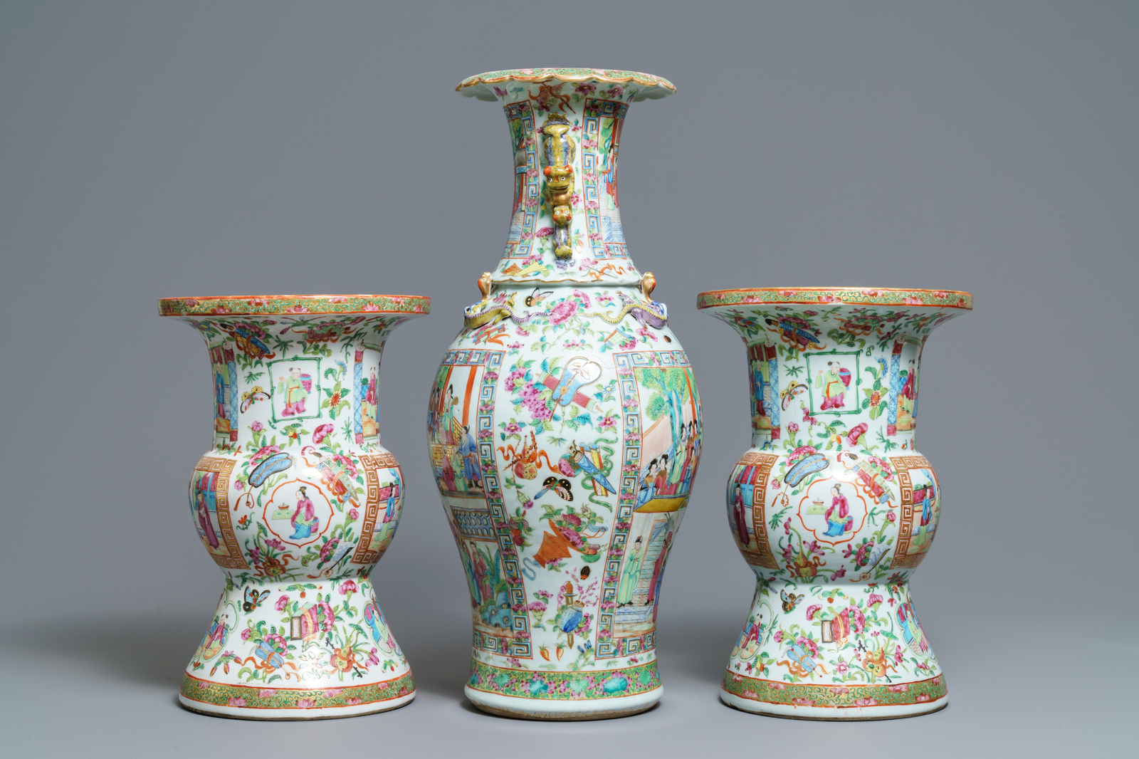 A pair of Chinese Canton famille rose spittoons and a vase, 19th C. - Image 2 of 6