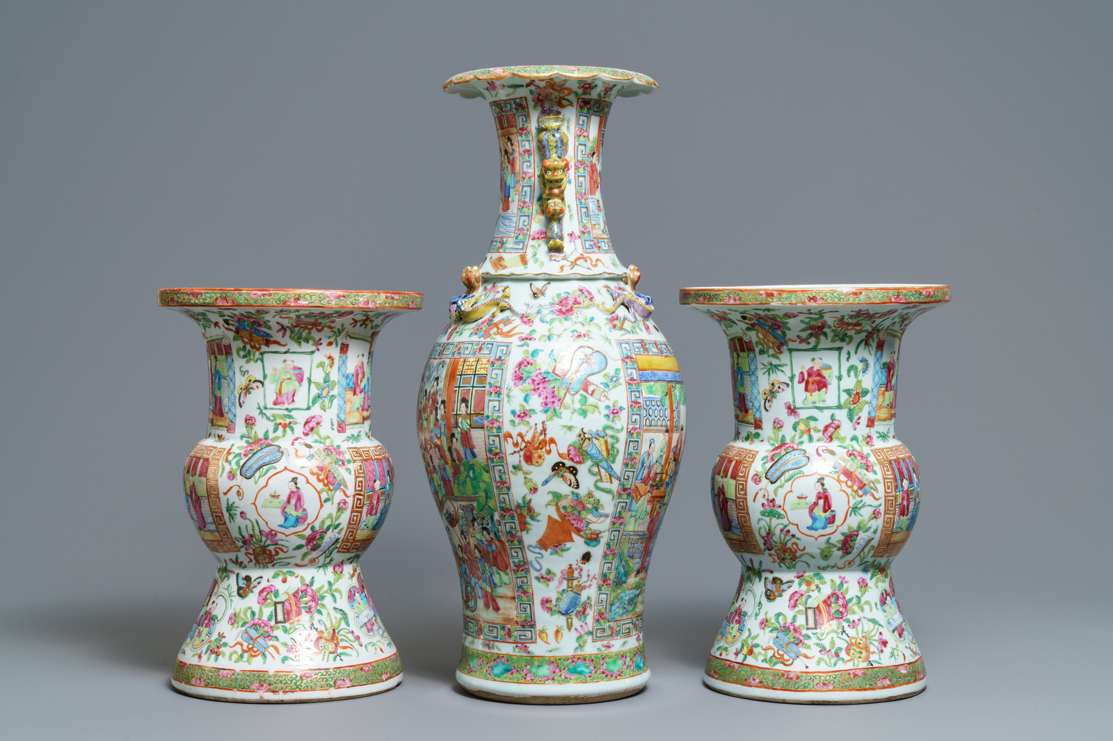 A pair of Chinese Canton famille rose spittoons and a vase, 19th C. - Image 4 of 6
