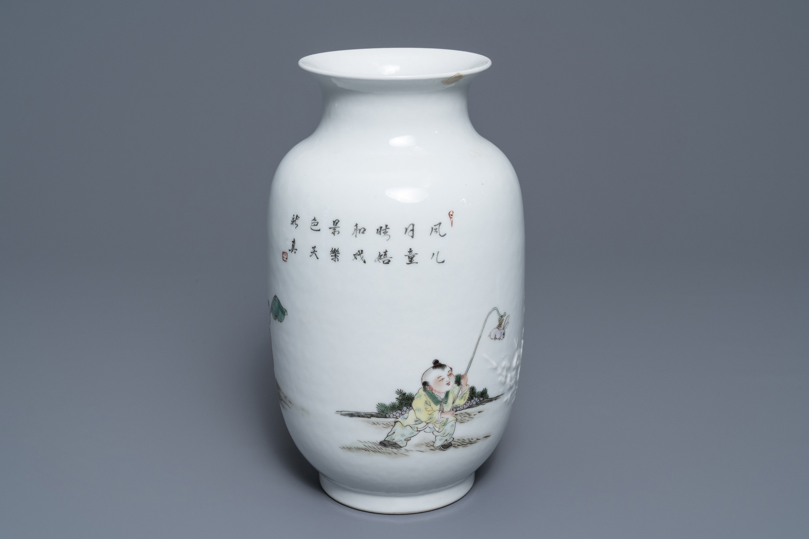 Lot 11 - A Chinese famille rose relief-decorated vase with playing boys, Qianlong mark, Republic, 20th C.