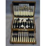 An oak canteen of silver plated cutlery, to include knives, forks, spoons, serving spoons,