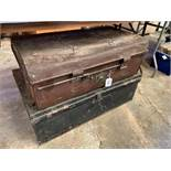 Two metal travelling trunks.