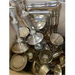 Box of boxed metal ware including silver plate candlesticks and goblets.
