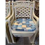 6 cream plastic garden armchairs.