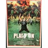 Two framed and glazed film posters, Platoon (1987) and Commando (1985).