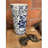 Blue and white china oriental umbrella stand and 2 Frith sculptures created by Paul Jenkins.