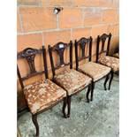 4 Mahogany framed open splat dining chairs.