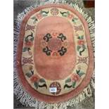 Two oval Chinese carpets.