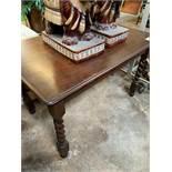 Oak dining table on barley twist legs.