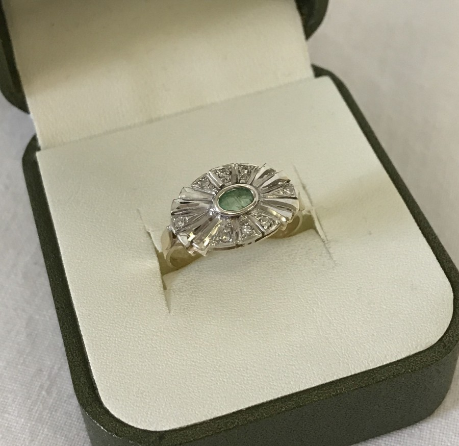 Lot 121 - A 9ct gold Art Deco style ring set with diamonds and central oval green stone.