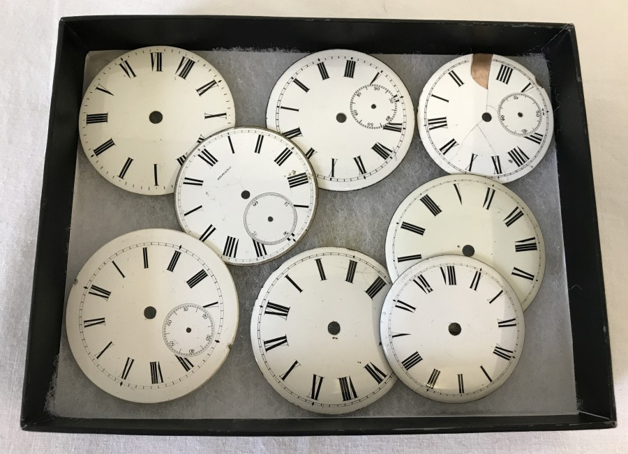 Lot 200 - 8 Vintage enamelled pocket watch faces.