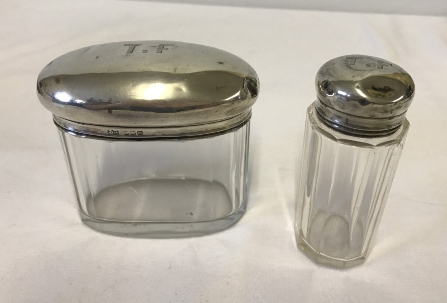 Lot 254 - 2 silver topped vanity jars monogrammed T.F.