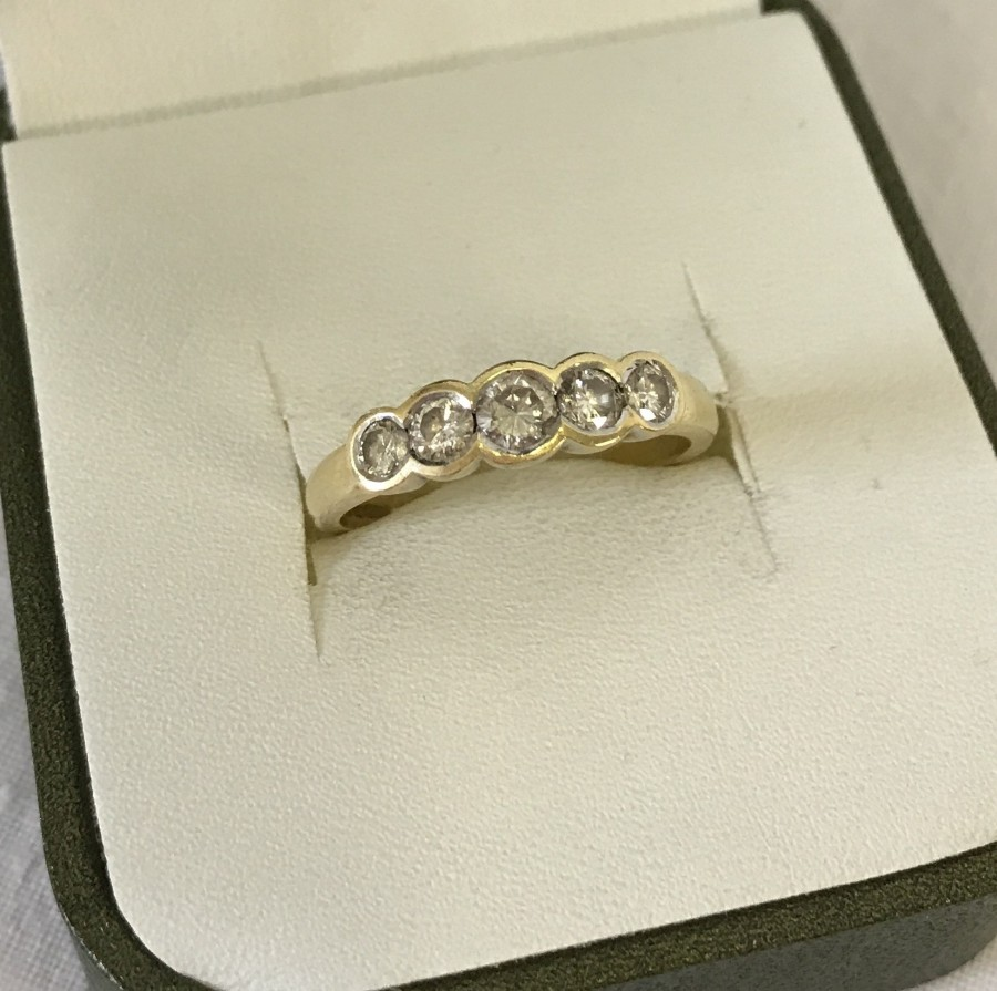 Lot 119 - A 18ct gold 5 stone diamond eternity ring. Total diamond weight 1/2 carat.