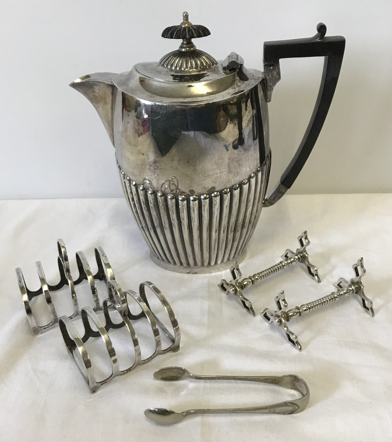 Lot 223 - A silver plates teapot with Deco style handle.