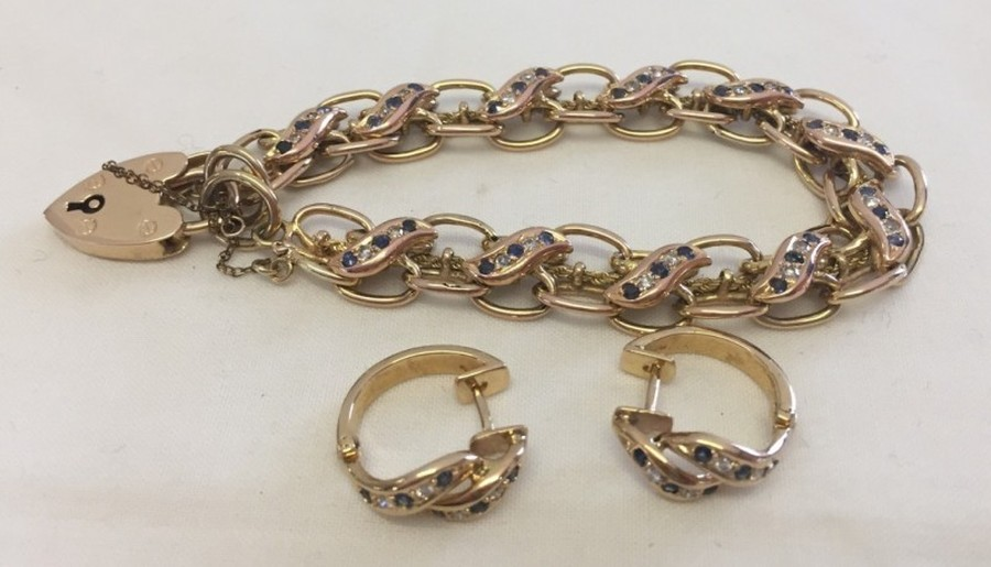Lot 60 - A 9ct gold double link bracelet with heart shaped lock clasp.