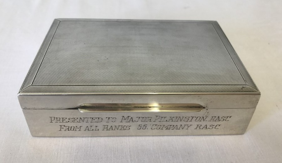 Lot 265 - A silver lined wooden cigarette box engraved to front and presented to Major Pilkington. RASC.