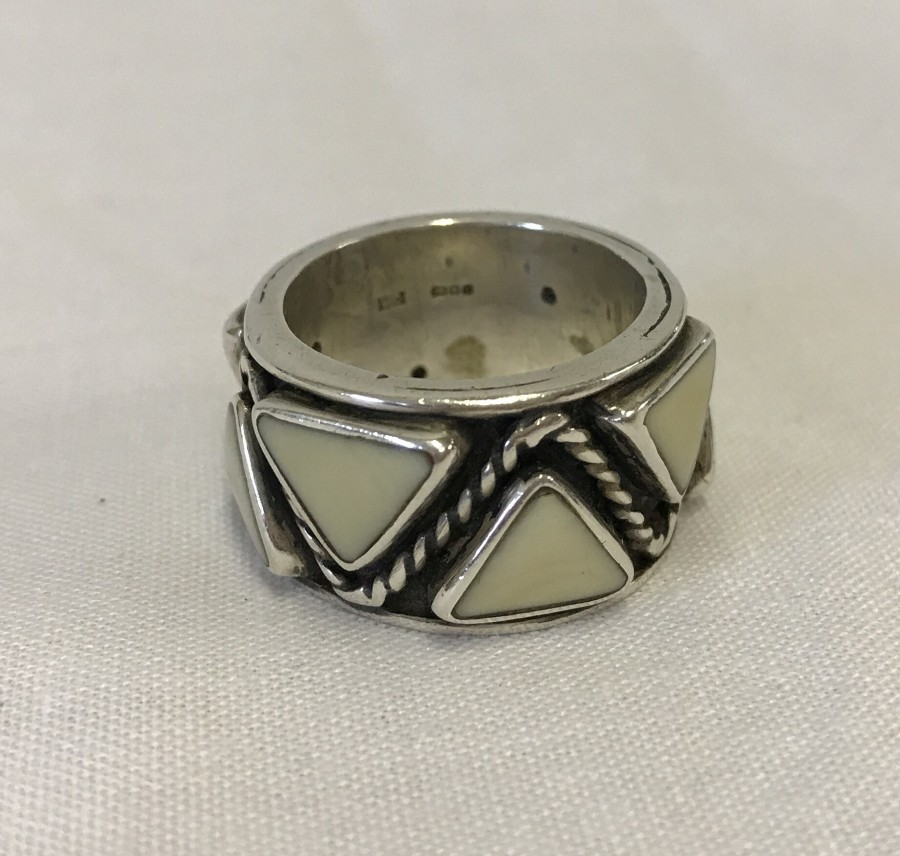 Lot 90 - A heavy hallmarked silver ring with triangle design.