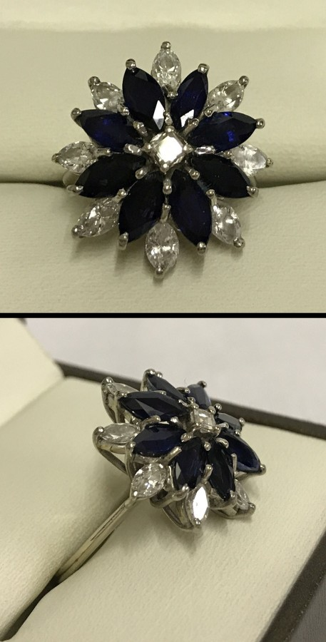 Lot 162 - An 18ct white gold sapphire & diamond cluster ring.