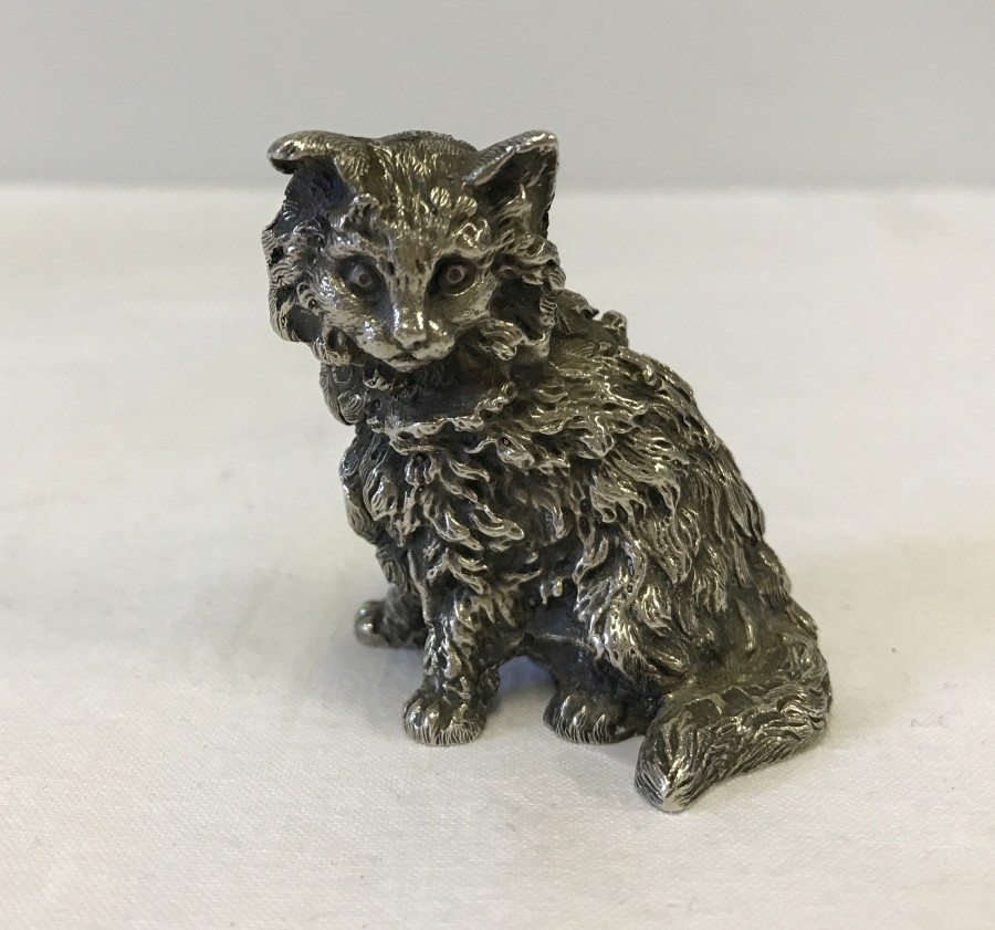 Lot 253 - A hallmarked silver salt shaker in the shape of a cat.