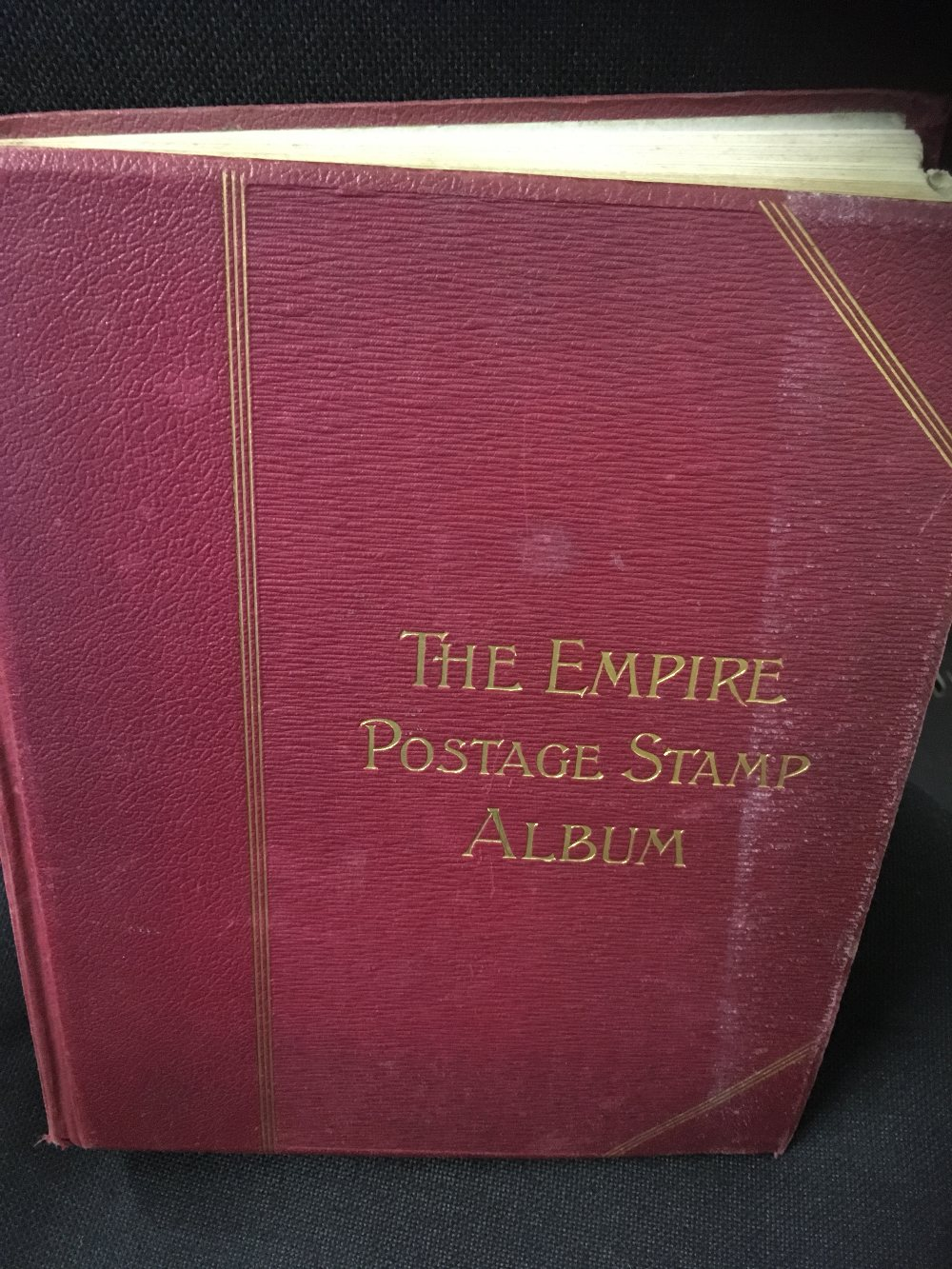 Lot 21 - STAMPS : WORLD, old Empire printed album with a good splattering of stamps throughout,
