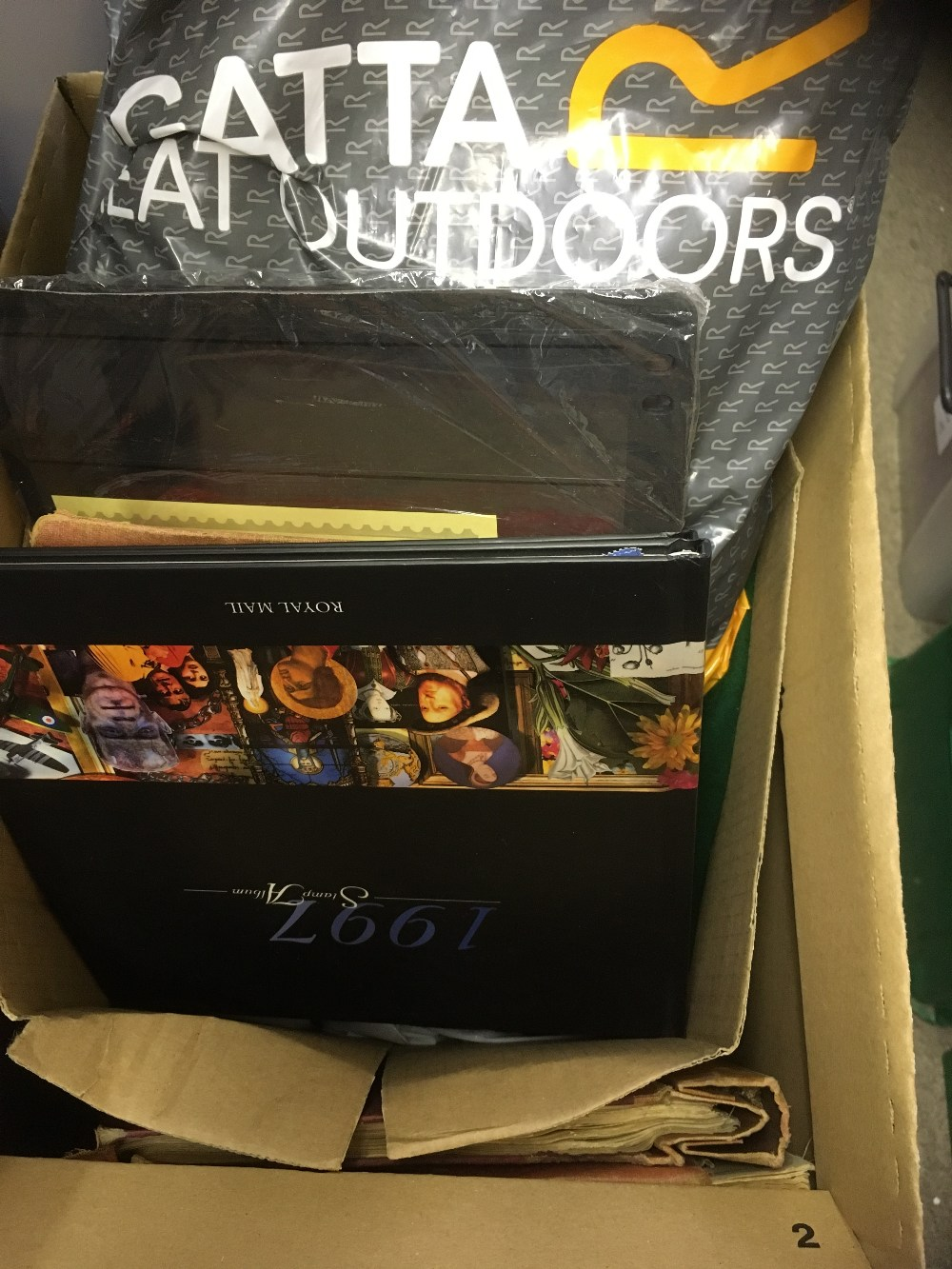 Lot 59 - STAMPS : Box including a couple of old time World albums, plus probably thousands of loose stamps .